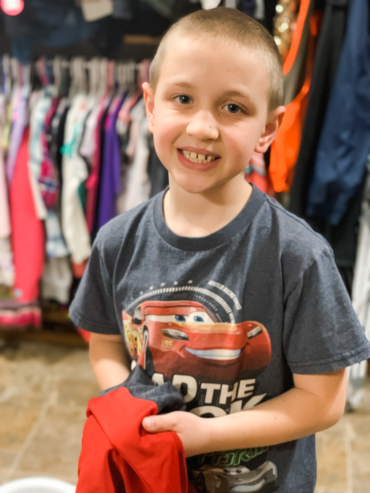 boy helping with laundry - Family Laundry Tips - Everyday Chores Made Easy With Whirlpool's Chores Club