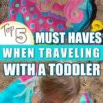 Beach Tote and Girl on Beach Towel 5 Must Haves When Traveling With A Toddler