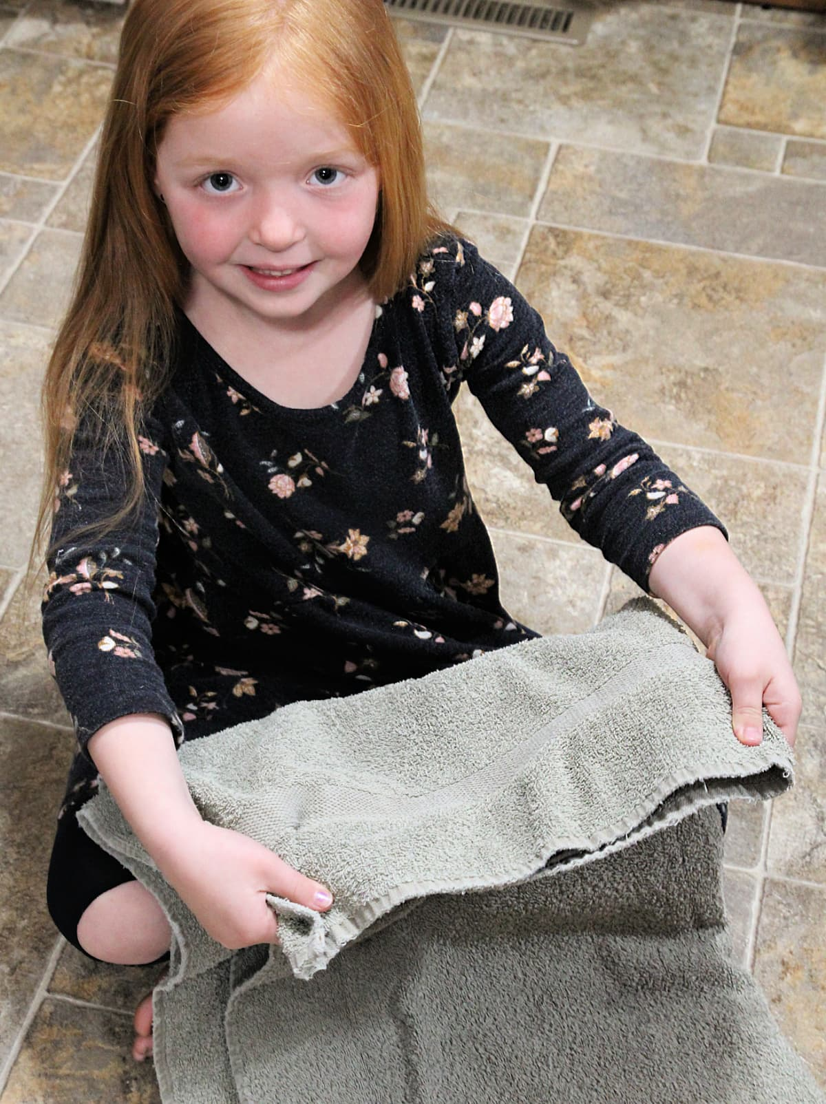 girl folding towels - Family Laundry Tips - Everyday Chores Made Easy With Whirlpool's Chores Club