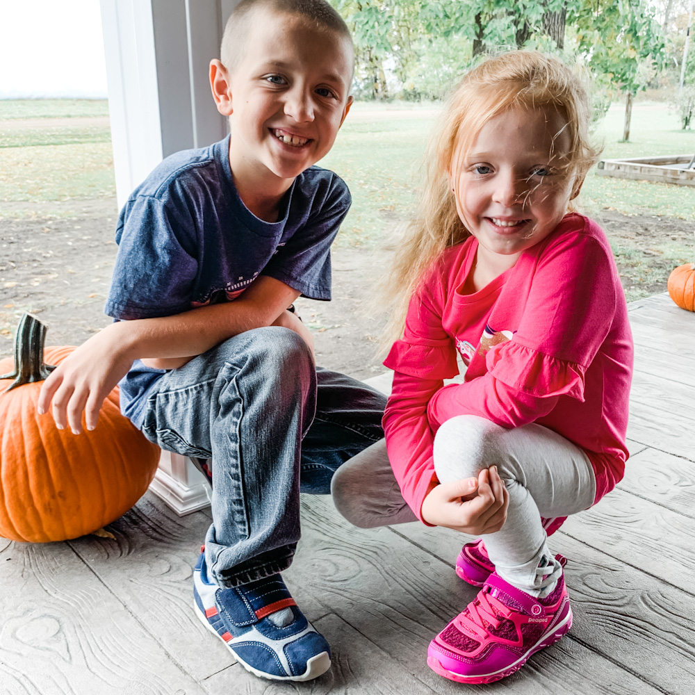 kids on a front porch - pediped shoes