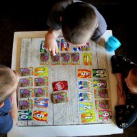 3 kids playing game- Tips For Planning A Fun Game Night