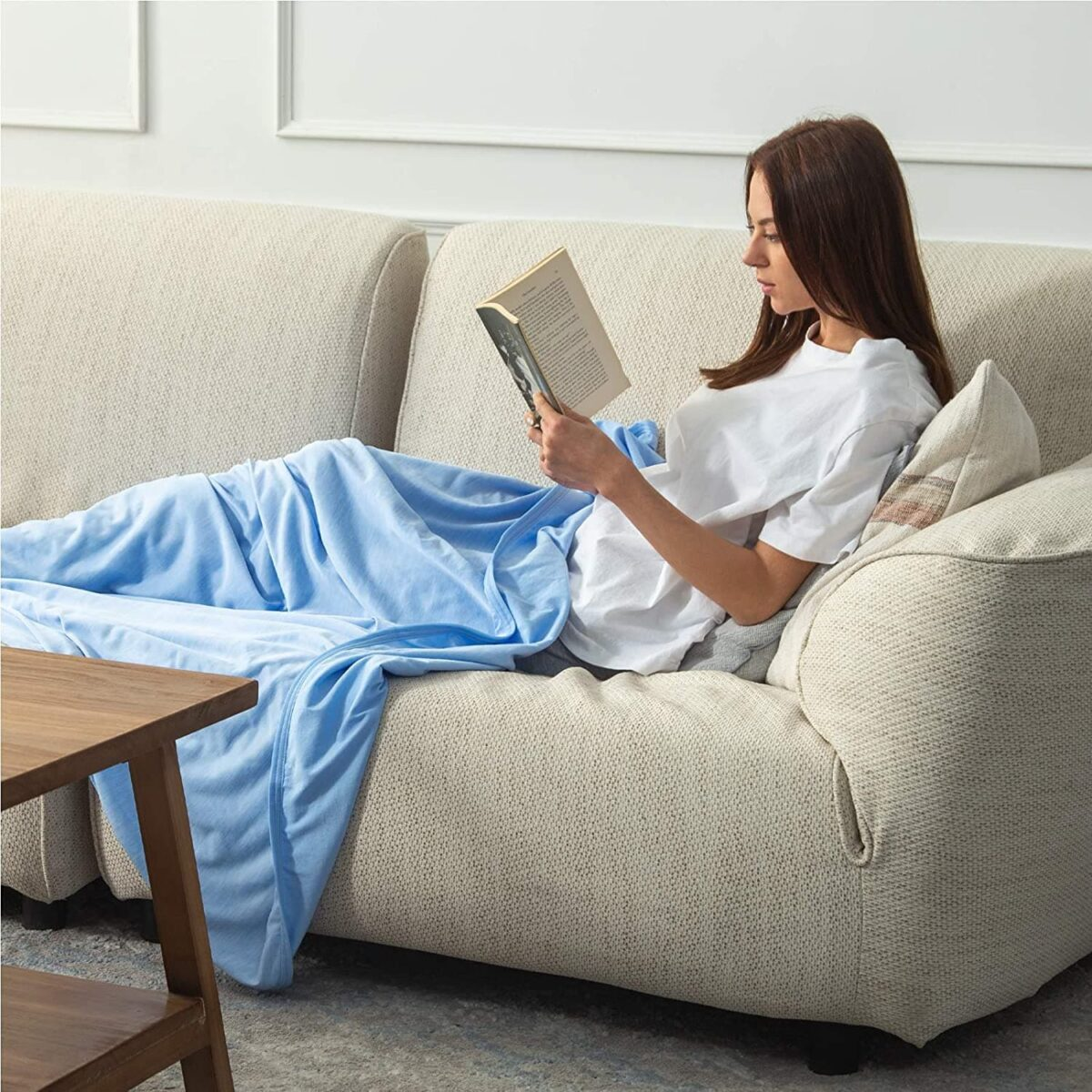 woman on couch reading - 5 Thoughtful Mothers Day Gifts For A New Mom