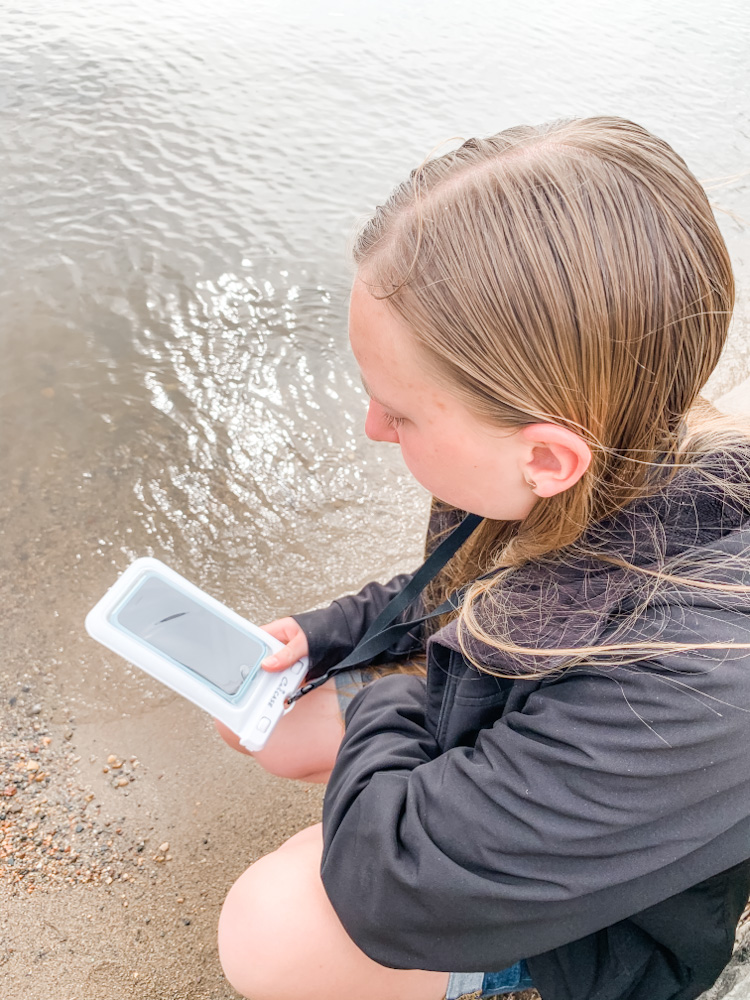 girl with phone at the beach - Best Universal Waterproof Phone Case For Vacation - CaliCase