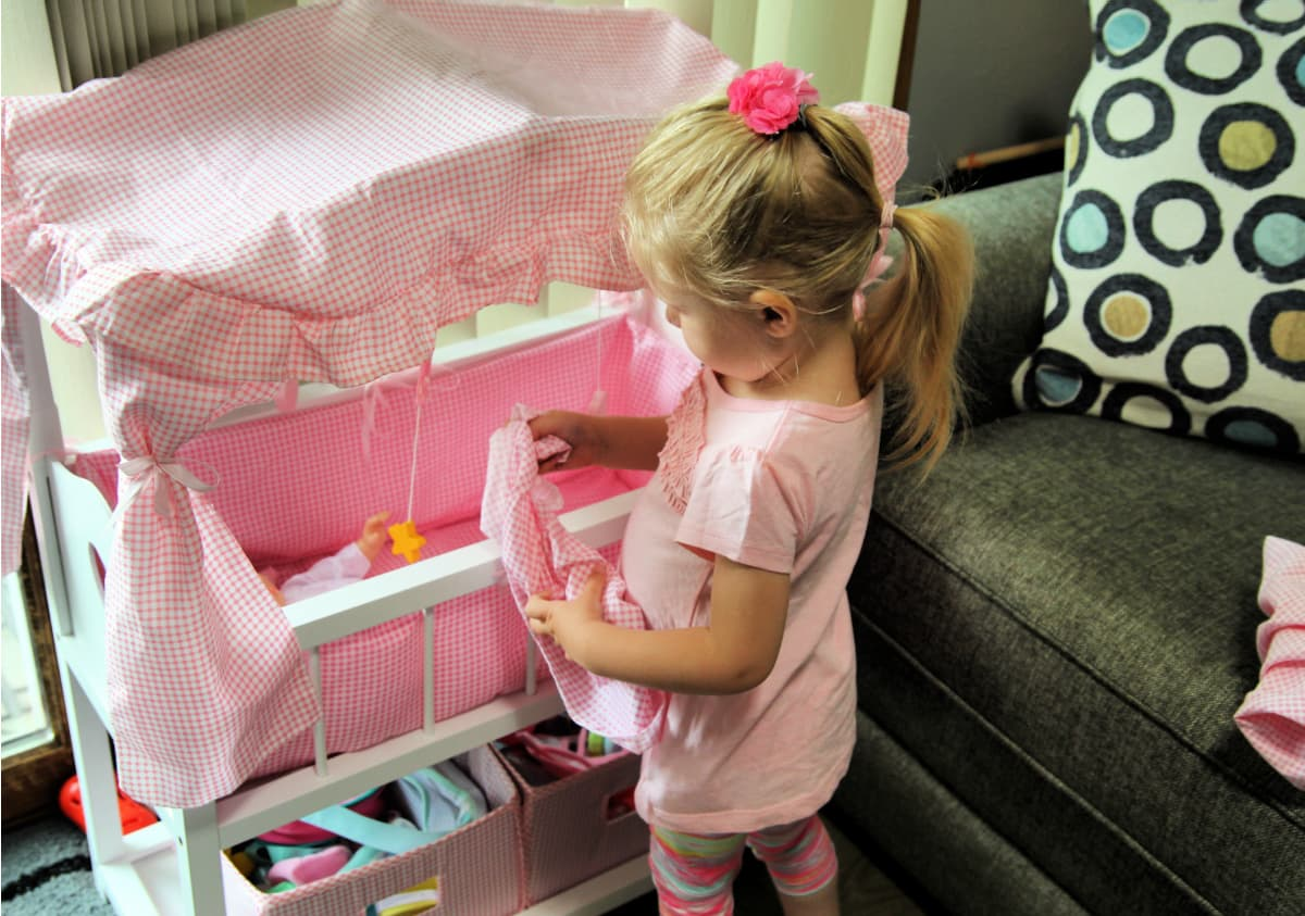Little Girl With Doll Crib- How to create a space for the mini mommy in your life