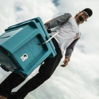 man carrying a cooler outdoors - Grizzly Cooler Giveaway! (Gift Idea For Dads)