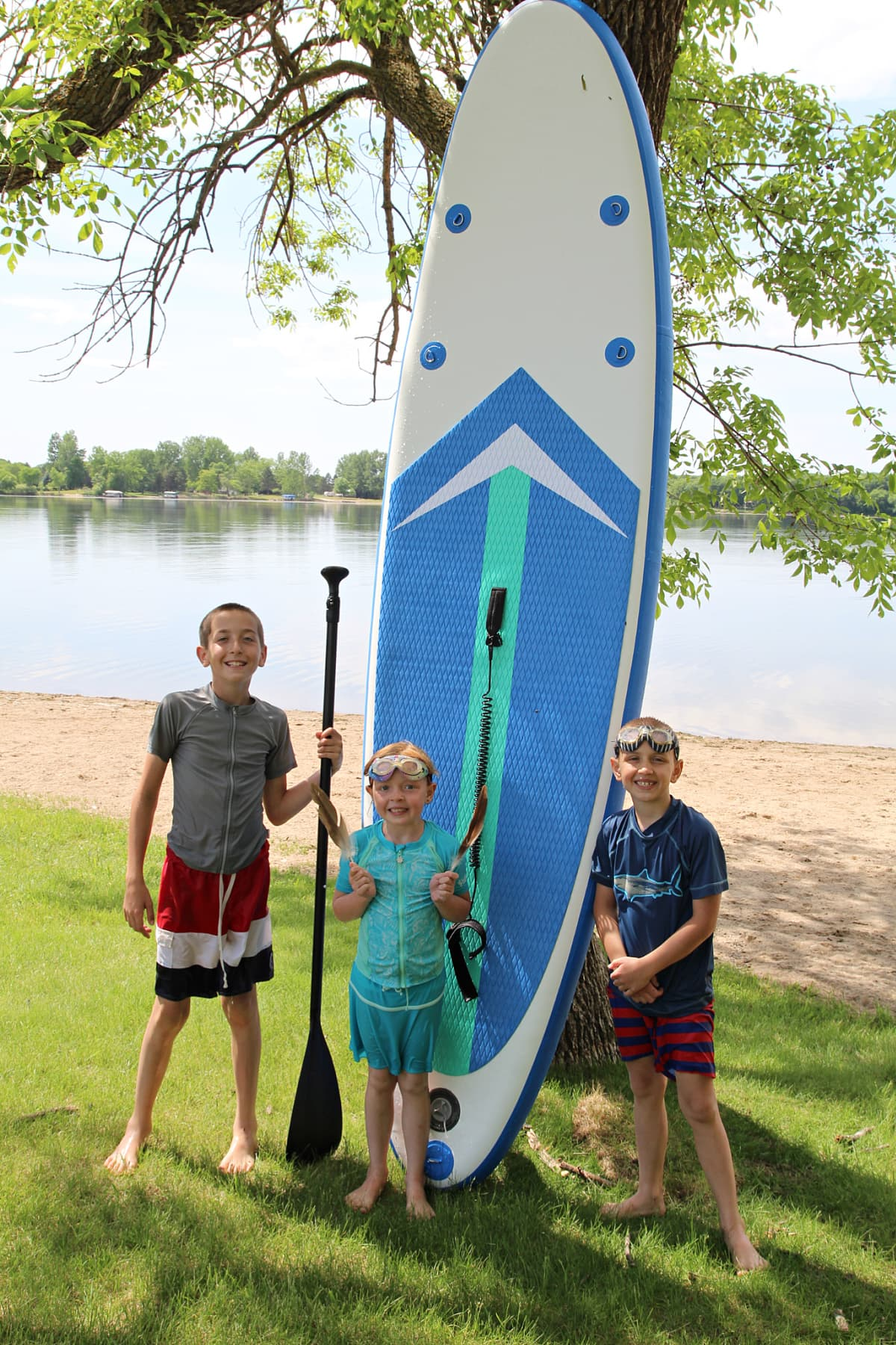 kids by paddle board - Soozier Inflatable Paddle Board Review + Discount
