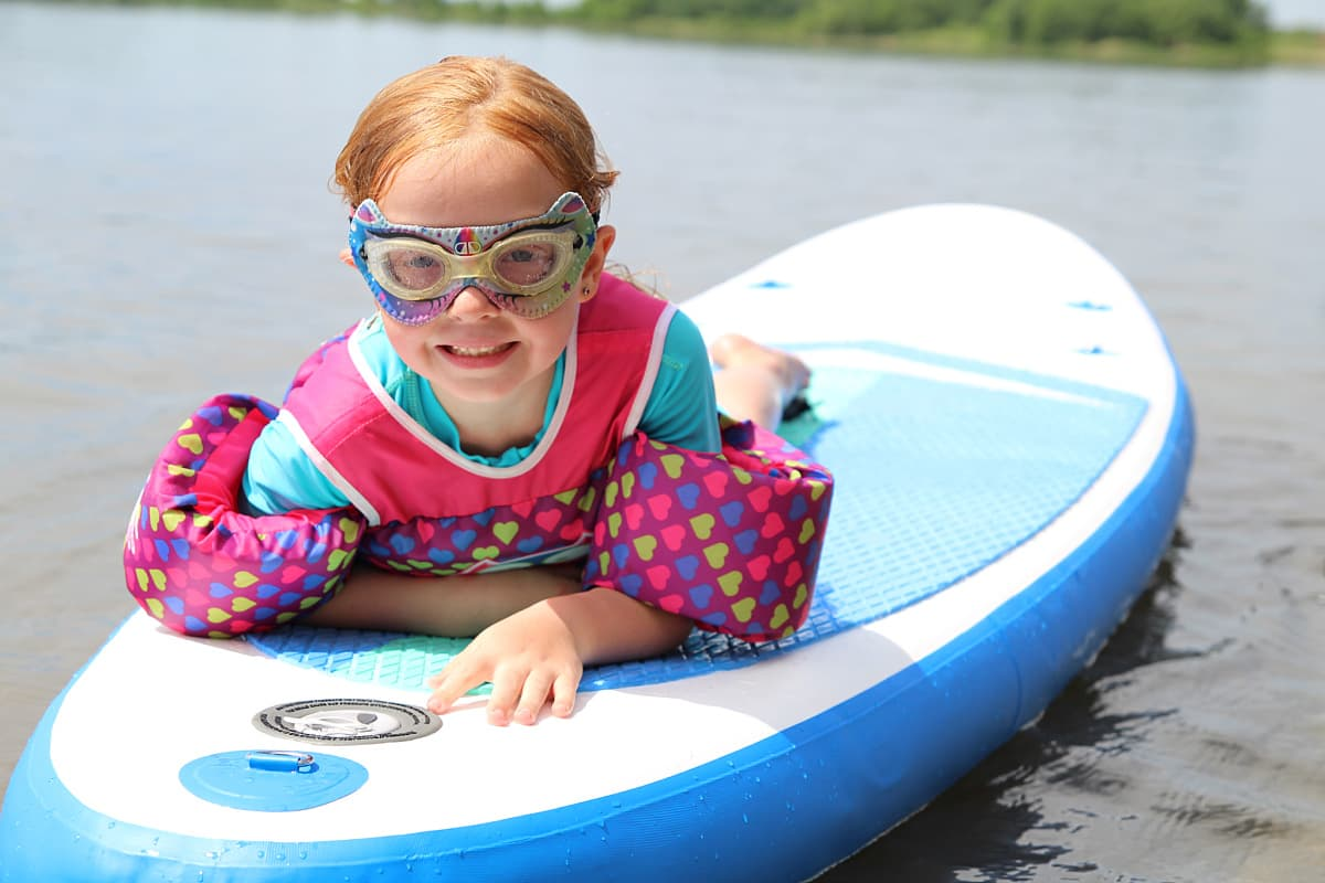 girl on paddleboard - Soozier Inflatable Paddle Board Review + Discount