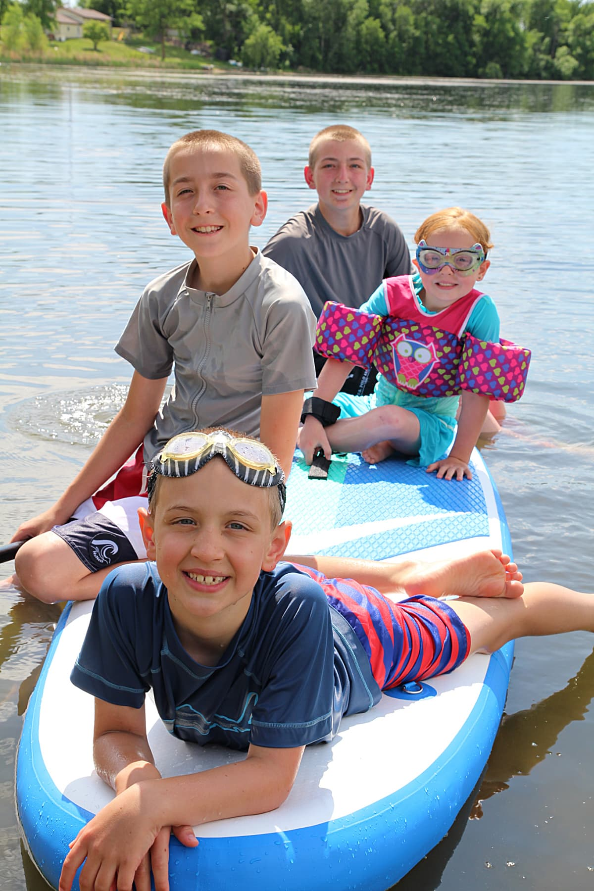 kids on an inflatable paddle board - Soozier Inflatable Paddle Board Review + Discount