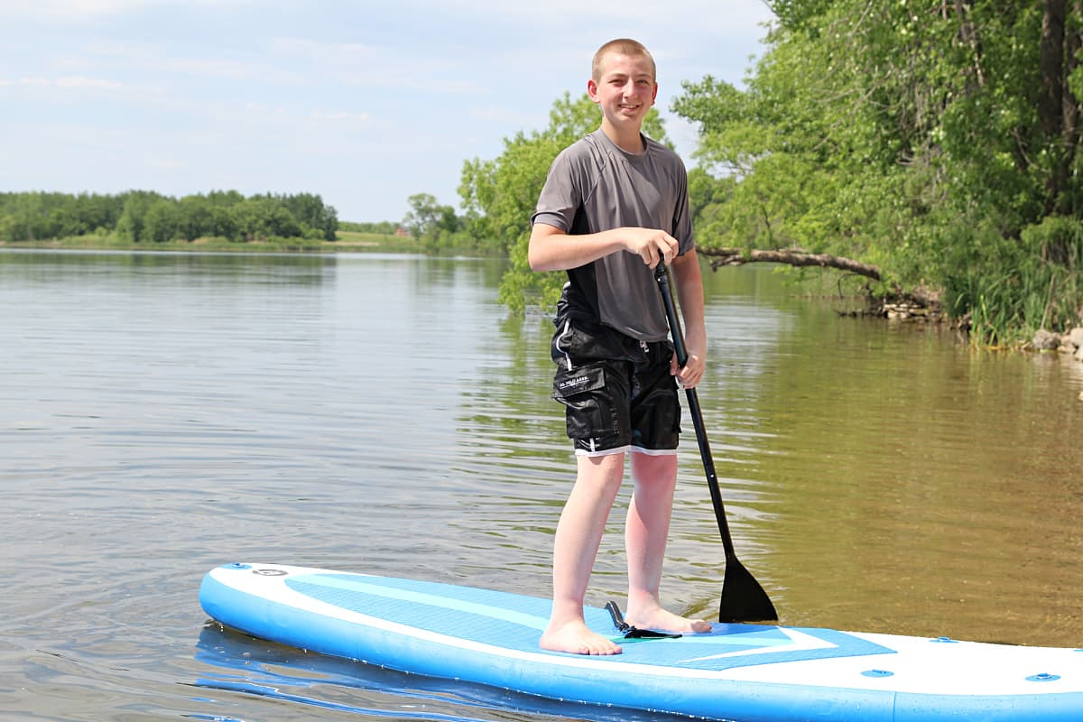 boy on paddle board - Soozier Inflatable Paddle Board Review + Discount