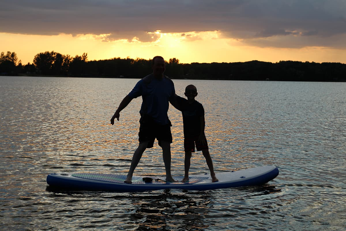 2 people on paddle board - Soozier Inflatable Paddle Board Review + Discount