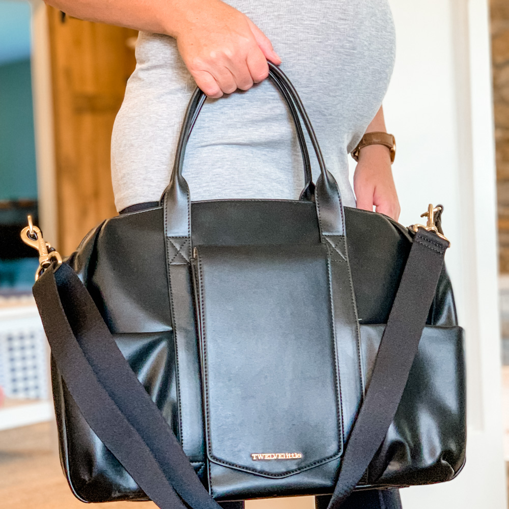 pregnant belly and diaper bag